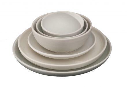 Stack of dinnerware.